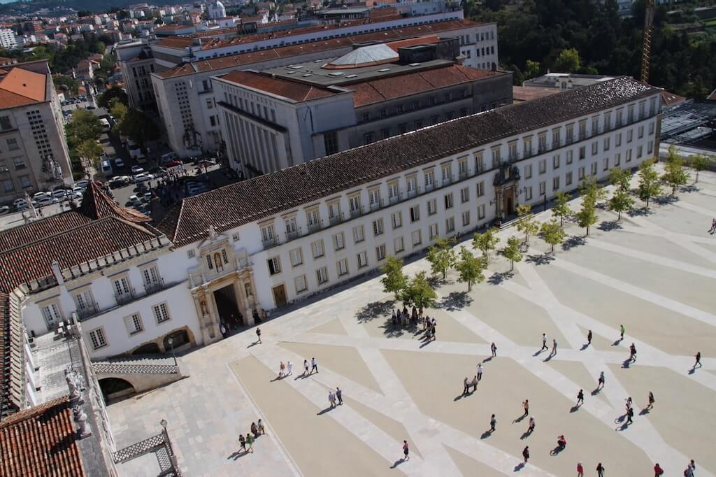 Large square in Coimbra with people wlking