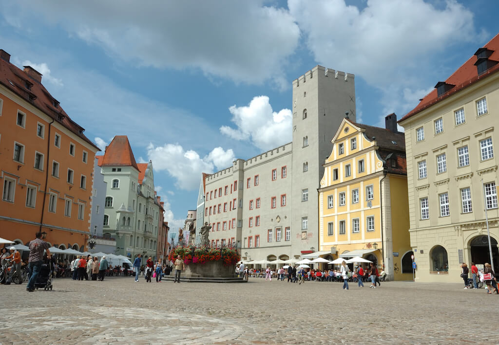 an open platz with colorful historical buildings