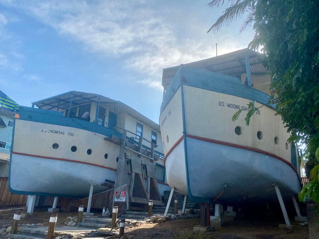 two blue boats on stilts