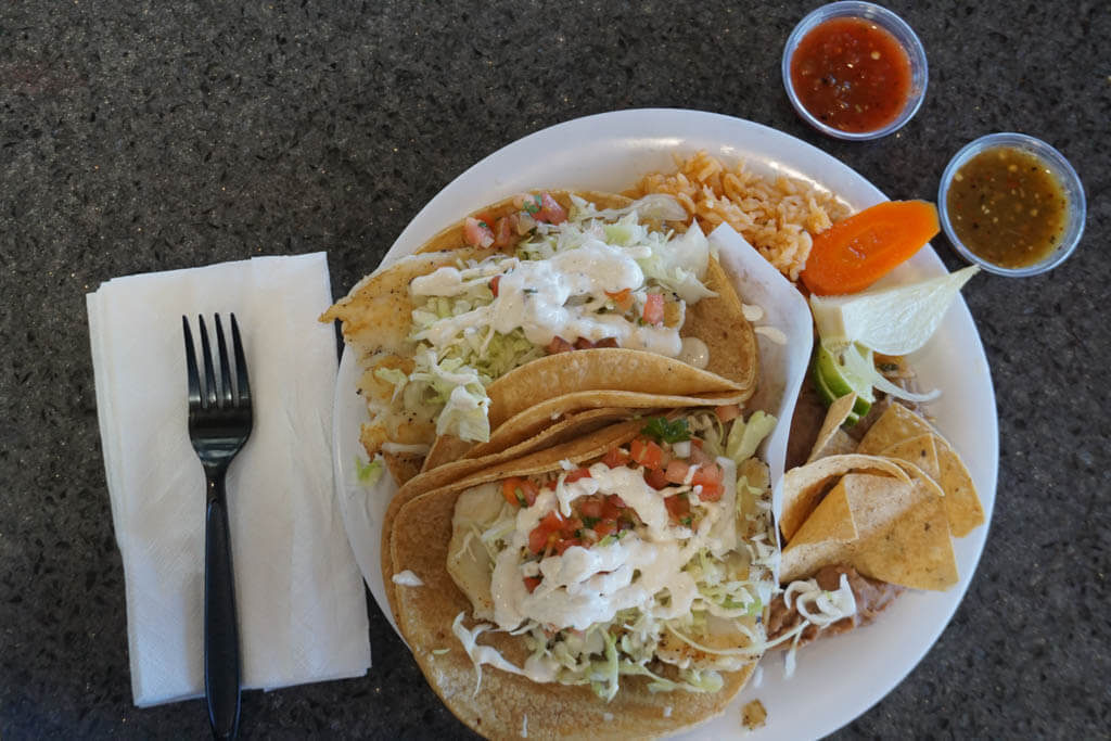 plate of fish tacos, rice and beans