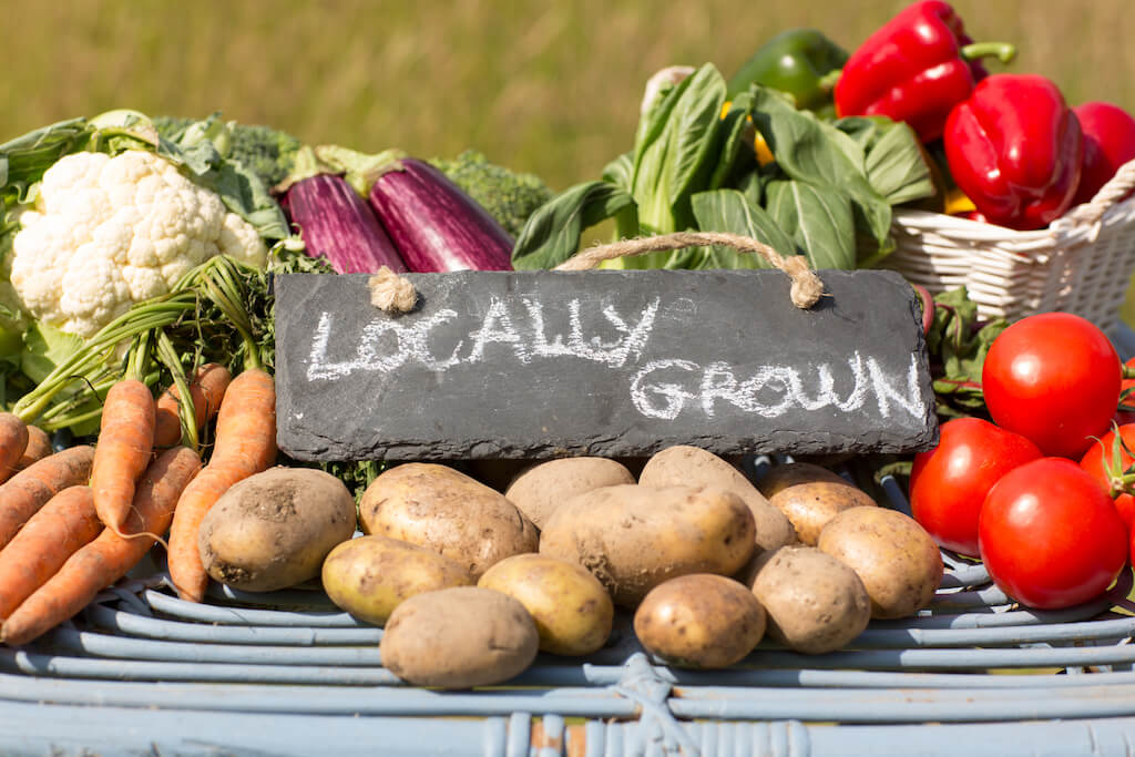 fresh produce and locally grown sign