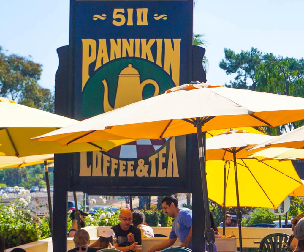 Pannikin sign and yellow umbrellas