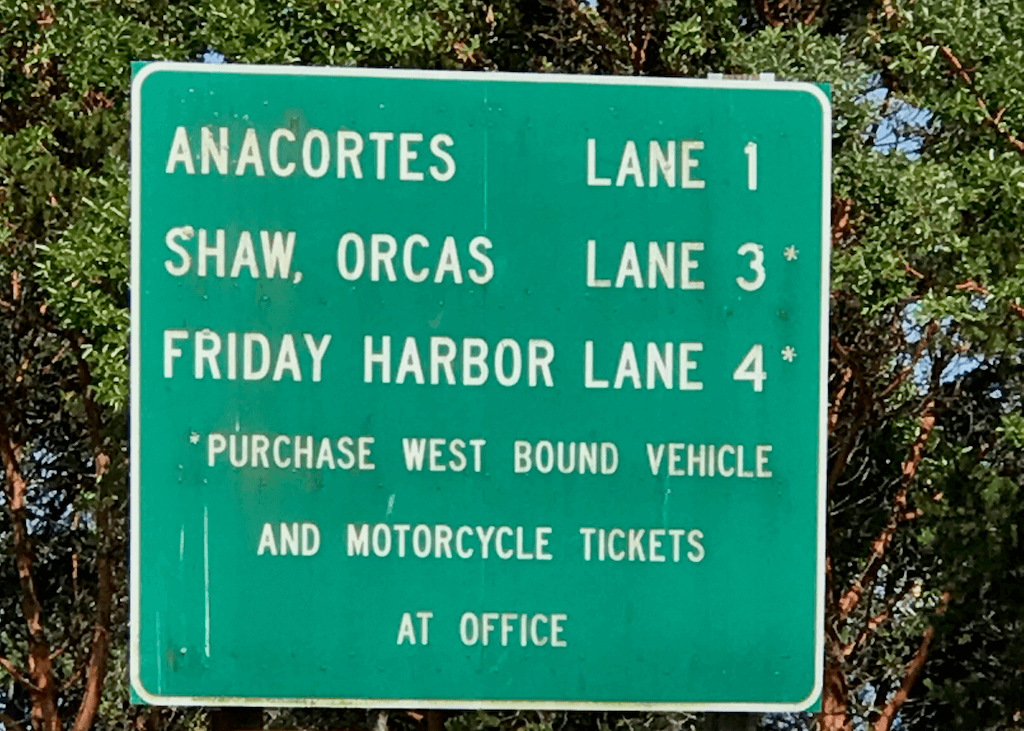 ferry terminal sign with destinations by queue lane