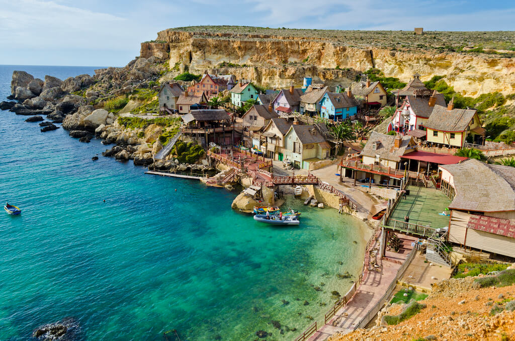colorful homes at the edge of the sea in Malta, one of the best places to enjoy winter in Europe